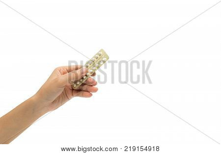Woman hand taking birth control pills. Asian adult woman holding pack of contraceptive pills isolated on white background with clipping path. Choosing family planning with birth control pills concept