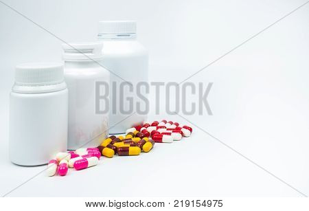Antibiotic capsules pills and plastic bottle with blank label isolated on white background with copy space. Drug resistance concept. Antibiotics drug use with reasonable and global healthcare concept.