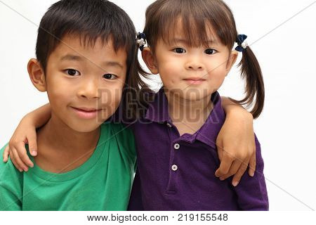 Japanese Brother And Sister Putting Arms Around Each Other's Sholders (8 Years Old Boy And 3 Years O