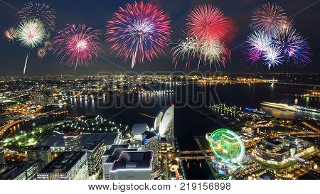 Firework with night light Yokohama cityscape hight view with modern building in Japan