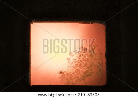 Molten metal in sand mold after pouring; iron casting process