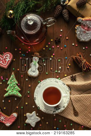 Festive mood. Hot tea with sweets. New Year.