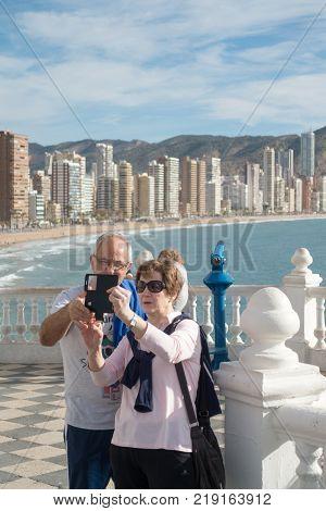 Benidorm Spain, December 14, 2017: Elderly couple taking a selfie in Mediterranean Balcony in Benidorm, Costa Blanca, Spain