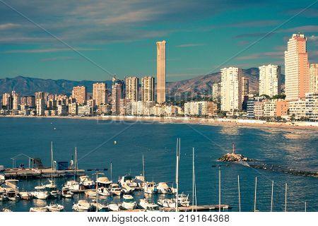 Benidorm, Spain, December 14, 2017: View to Benidorm Poniente beach with port and boats in Benidorm, Costa Blanca, Spain.