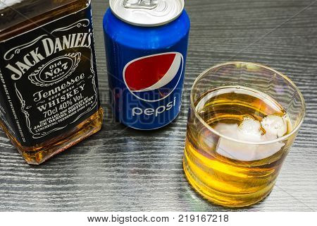 Niedomice Poland - December 20 2017: Jack Daniel's Tennessee Whiskey. A glass of whiskey with ice and can of pepsi.