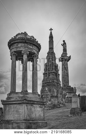 Black and white view of the necropolis graveyard in Glasgow Scotland.