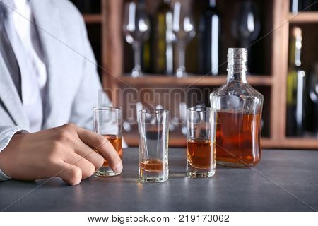 Man drinking whiskey in bar. Alcohol dependence concept