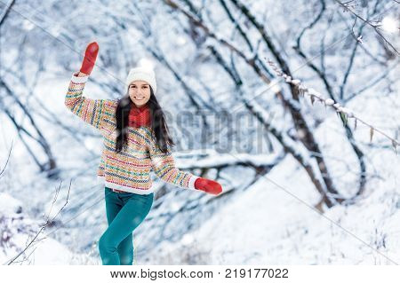Winter young woman portrait. Beauty Joyful Model Girl laughing and having fun in winter park. Beautiful young woman laughing outdoors. Enjoying nature, wintertime.