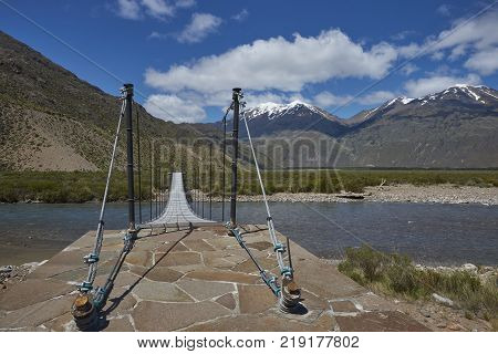 Footbridge over the Rio Aviles O Pedregoso in Valle Chacabuco in northern Patagonia, Chile