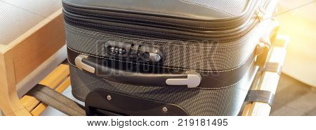 Hotel room with a suitcase on the luggage place. Long wide banner