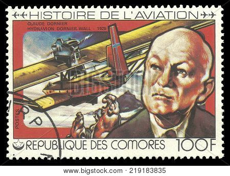 Comoros - CIRCA 1978 - stamp printed by Comoros Color memorable Edition offset printing on Topic of Aviation History, Shows Claude Dornier and the seaplane Dornier-Wall 1925
