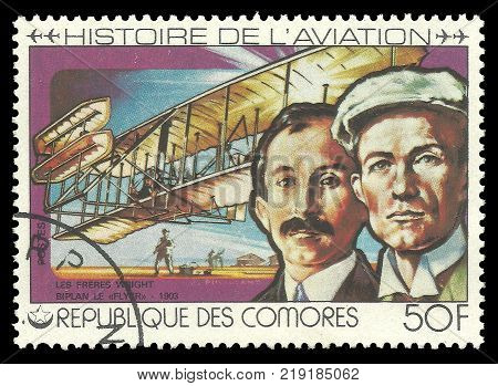 Kiev, Ukraine, 12.22.2017 - CIRCA 1977: stamp printed by Comoros Multicolor memorable Edition offset printing on Topic of Aviation History Shows Wright brothers 1903 and their aircraft