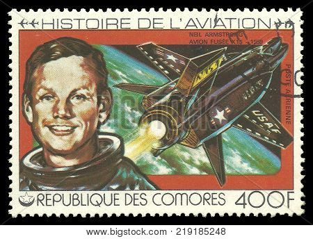 Kiev, Ukraine, 12.22.2017 - CIRCA 1981: Stamp printed by Comoros Multicolor memorable Edition offset printing on Topic of Aviation History Shows Neil Armstrong and Space craft