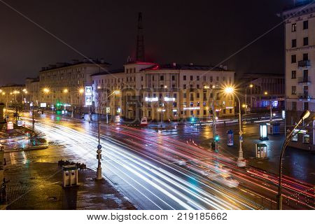 Minsk, Belarus - December 8, 2017: Lights Of The Night City. Light Headlights Car Night Prospectus