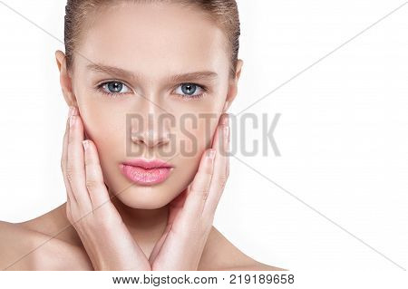 Beauty Of A Woman's Face. Natural Makeup, Pink Lips, Clean Skin. Isolated White Background.