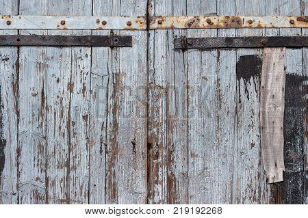 Exterior doors of an old wooden barn in village