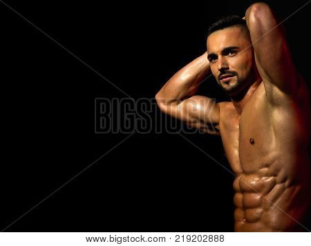 Athletic Bodybuilder Man On Grey Background.