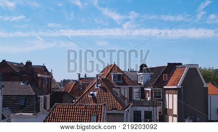 Old traditional Dutch city rooftops on a clear blue sky. Leiden, The Netherlands