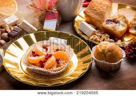 christmas breakfast with muffin fruits cake and juce