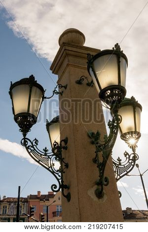 Sofia Bulgaria - March 03 2017: Sun rays through the ornaments of decorative street lamps on Lions Bridge Sofia Bulgaria Eastern Europe