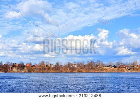 View of Neva river on the outskirts of St. Petersburg at spring day Russia.