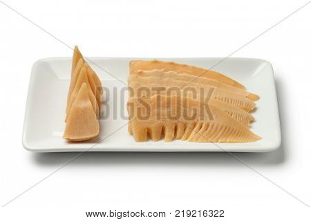 Japanese simmered young bamboo shoots on a dish on white background