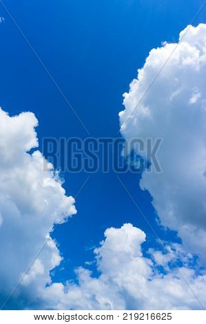 Cloud in the blue sky.Middle level altocumus and altostratus with low stratus cloud formations on a sunny late afternoon in summer are contrasted against the blue Australian sky.