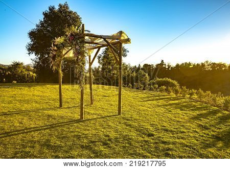 Outdoor sunset view of a Jewish traditions wedding ceremony. Wedding canopy chuppah or huppah .