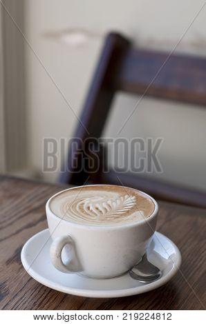 Fern motif on a coffee in a New Zealand cafe