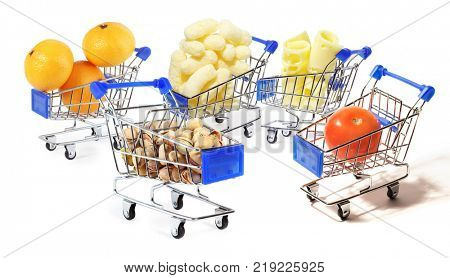 Collage with food in shopping cart isolated on white background