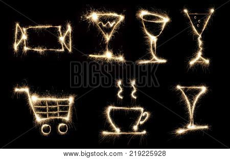 collage of figures with Begal lights, sparks, seven images (candy, glasses, cup, food basket)