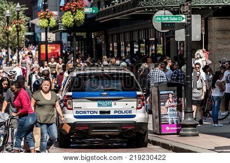 BOSTON MASSACHUSETTS USA 06.09.2017 Boston Police car in the city between public many people patrol