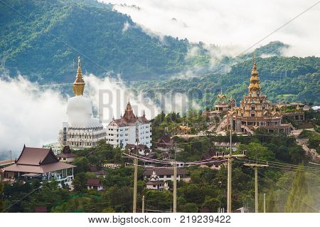 Phetchabun Province Thailand - September 3 2017: Big White Buddha statues sitting at Wat Pha Sorn Kaew Temple or Wat Phra Thart Pha Kaew Temple in Khao Kho Thailand. One of the most popular landmark in Thailand.
