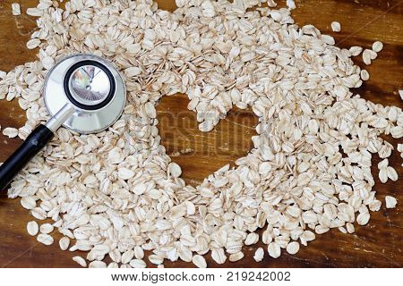 Fitness and health concept. Stethoscope, rolled oat and heart shape