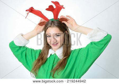 Young Female Model Christmas Photo Session. Twenty Years Old Girl In Elf Costume.