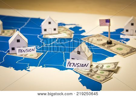 Family houses with dollar bills and pension word over a US map.USA finance and economy concept related to the retirement and pension saving plan from families