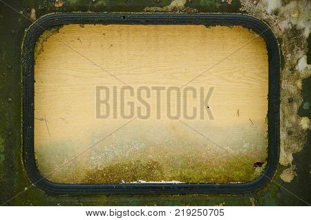Old window with plywood instead of glass looks like TV, frame with space for writing, background