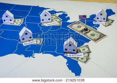 Family houses with dollar bills and pension word over a US map.USA finance and economy concept related to the retirement and pension saving plan