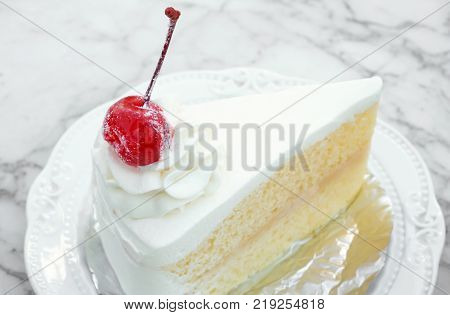Closeup Milk cake with delicious on white marble table in coffee shop sweet and dessert concept selective focus