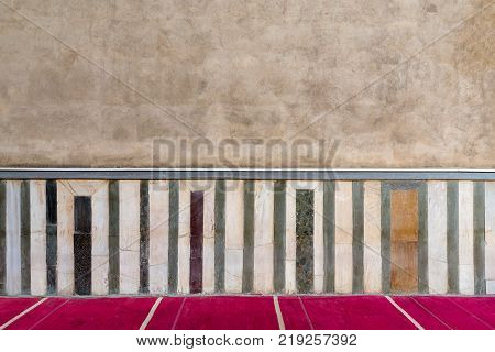 Old grunge stone wall decorated with colorful marble pattern Cairo Egypt