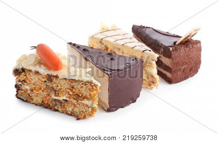 Pieces of tasty cakes on white background