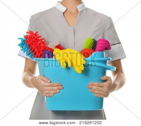 Woman with cleaning supplies on white background, closeup