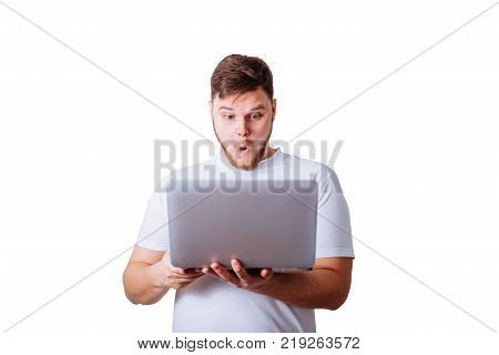 wondered man standing with laptop in white t-shirt with white background