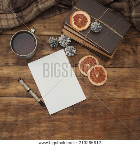 Diary With A Pen, Books, An Aluminum Vintage Cup With Hot Tea, An Old Photo Camera And Slices Of Dri