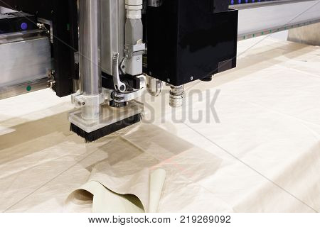 CNC machine for cutting fabrics textile materials and leather laser marking and measurement. Modern footwear production.