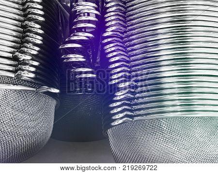 Stainless steel kitchen sieves together. Image of strainer. Kitchenware shop