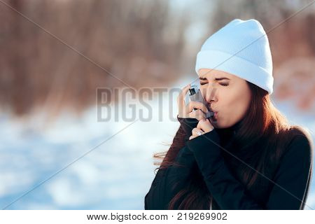 Woman with Inhaler Suffering Asthma Attack in Winter