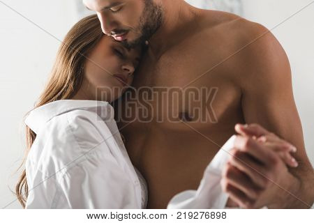 close-up shot of attractive young couple dancing at home in morning