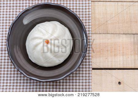 Chinese dim sum BBQ Pork Bun Pandan pau or bao in plate