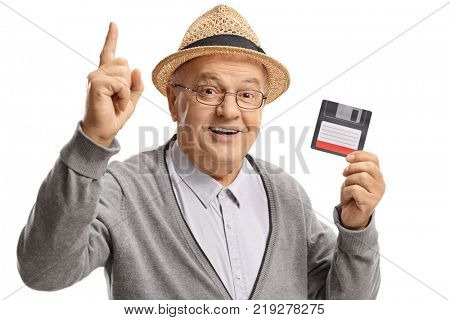 Mature man with a floppy disk holding his index finger up isolated on white background